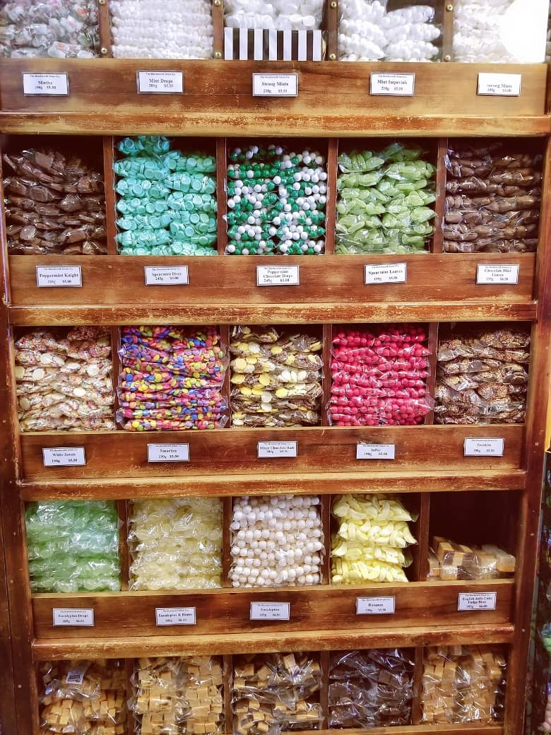 a picture of a shelf full of candies in various flavors and sizes