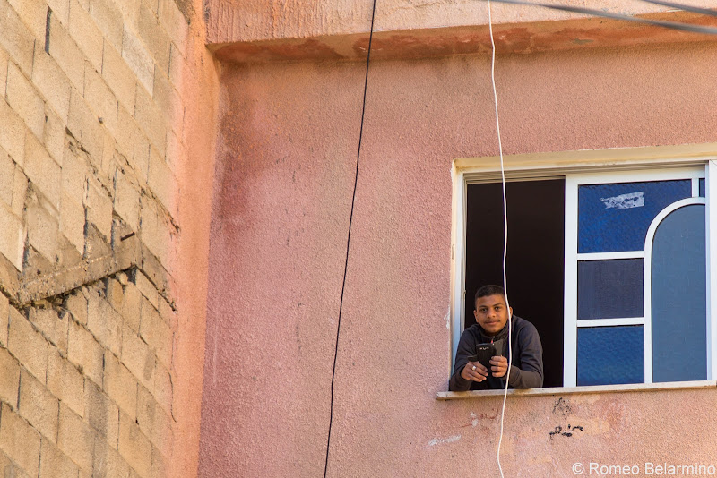 Kid Looking Out a Window Jisr az-Zarqa Israel