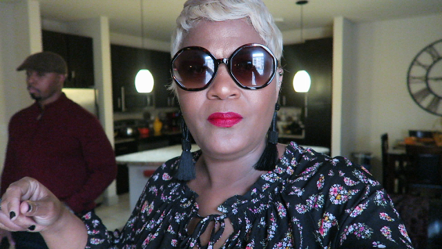 Image: Woman sharing her new glasses in a haul purchased from Target.
