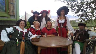 Happy group of Renaissance faire participants dressed in renaissance period clothing.