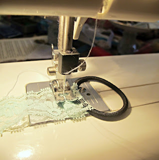 image sewing lace ribbon on to a hair elastic using a sewing machine