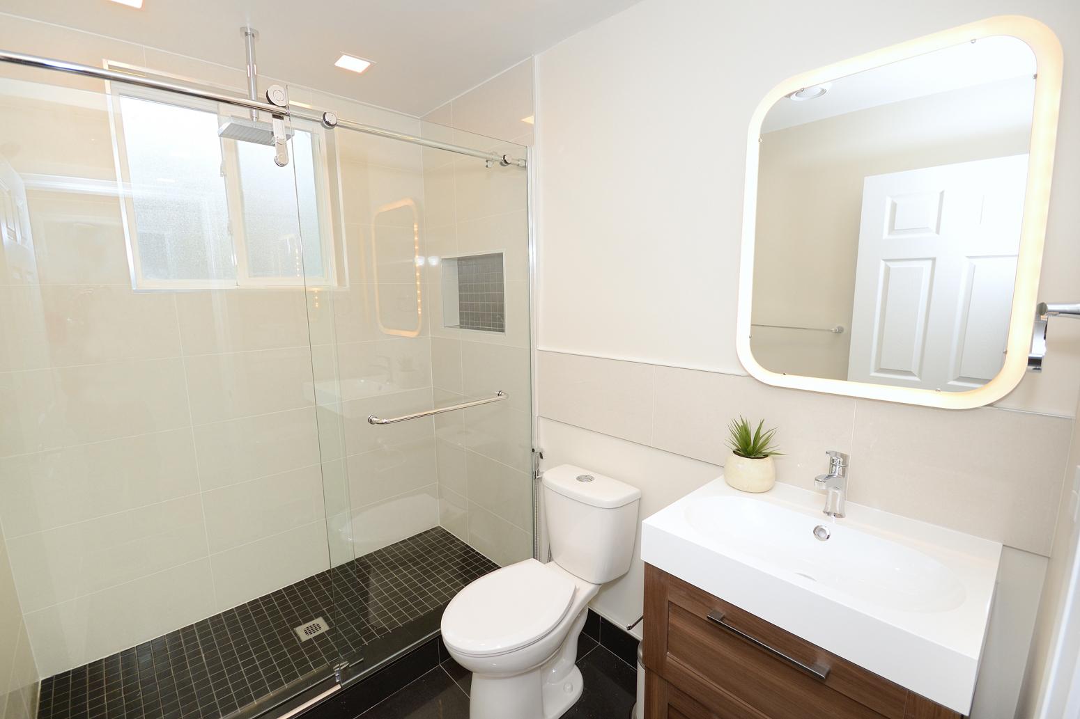 modern washroom reno by wilde north interiors
