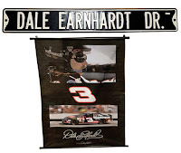 Hascar pennant for #3 Earnhardt, and a tin street sign saing Dale Earnhardt Drive.