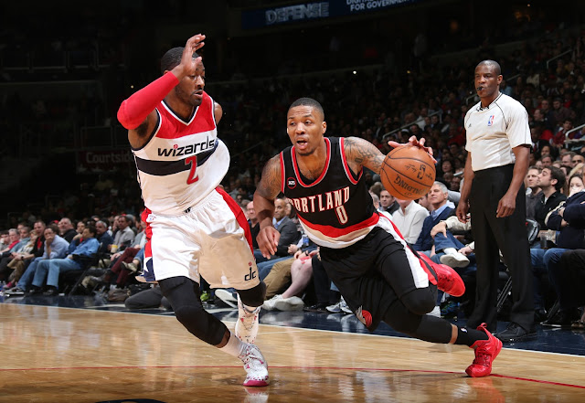John Wall (Washington Wizards) et Damian Lillard (Portland Trail Blazers) lors d'un match NBA.