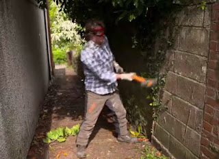 David uses a sledge hammer to break down the wall