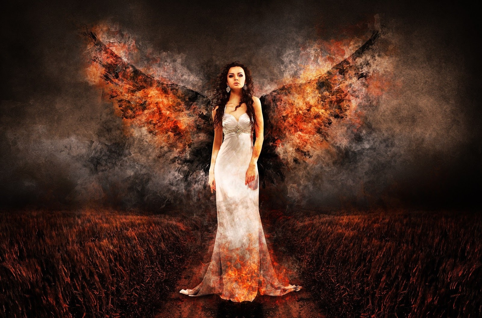 woman in long white dress stands in a burning field with angel wings coming out of her shoulders to illustrate a blog post about war movie standoffs
