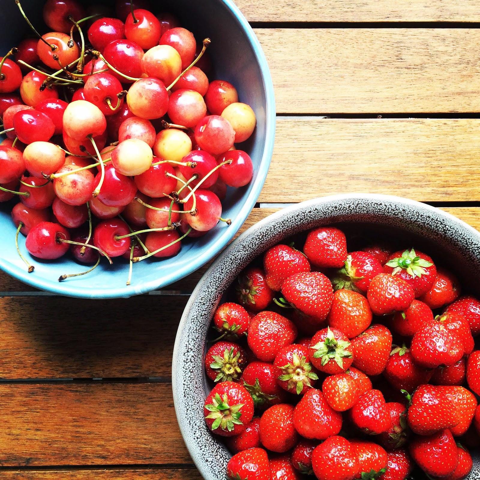 fresh cherries strawberries wood table