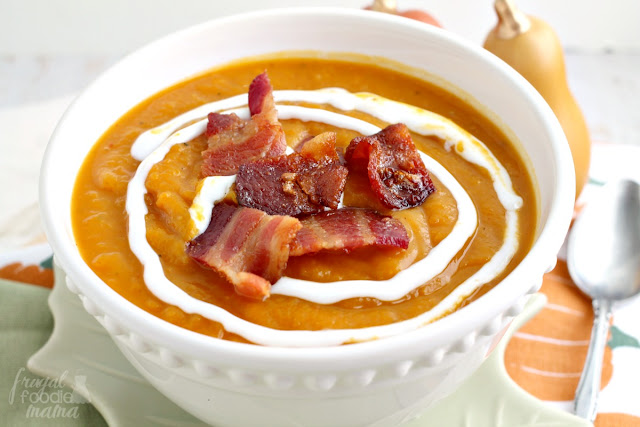 Roasted butternut squash & creamy pumpkin are blended together with warm spices & a little kick of heat in this perfect for fall Chipotle Butternut Squash & Pumpkin Soup.