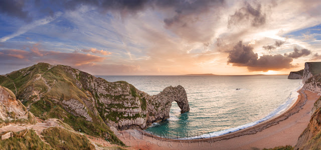 Sunset light on the Jurassic Coast at Durdle Door in this panoramic image