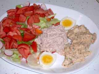 hard cooked egg with tuna salad plate