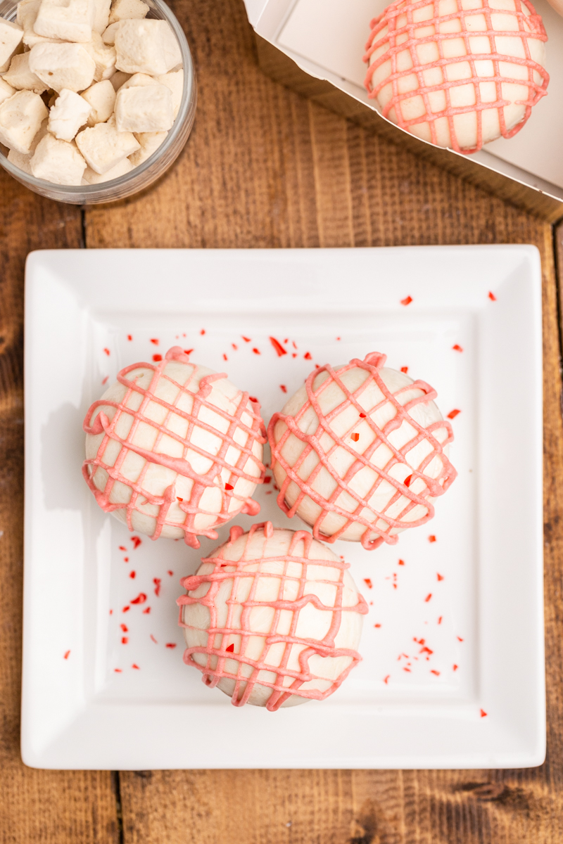 Closeup overhead photo of Keto Valentine Hot Chocolate Bombs on a white platter.