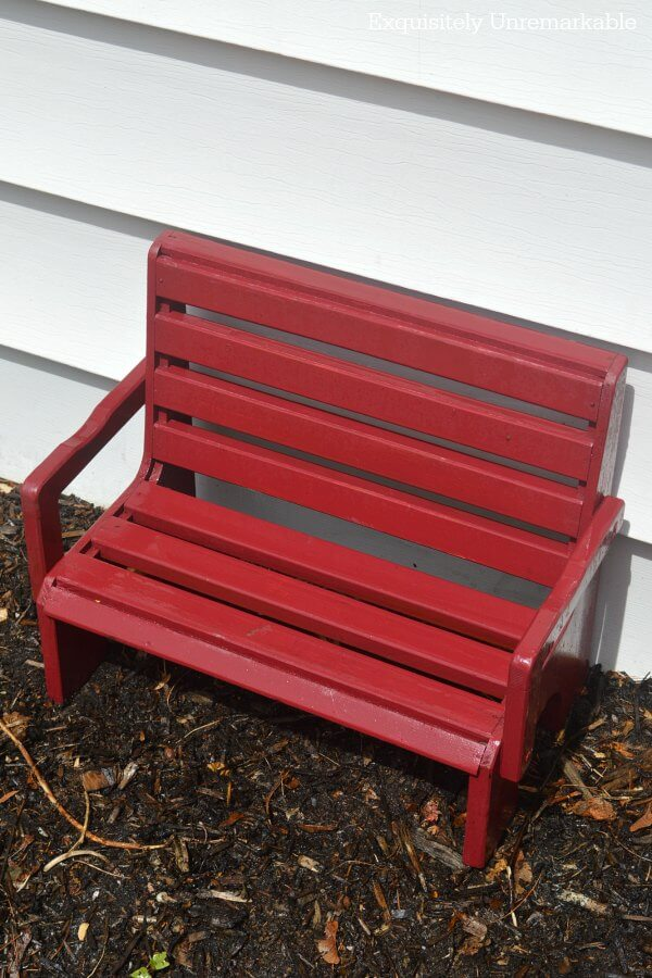Little Red Wooden Bench in dirt patch