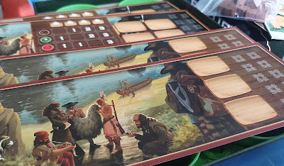 Century A New World game player boards with spaces for bonuses