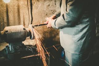 person-grinding-metal