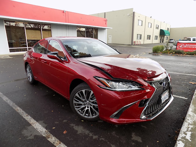 2019 Lexus ES300h with collision damage at Almost Everything Auto Body.