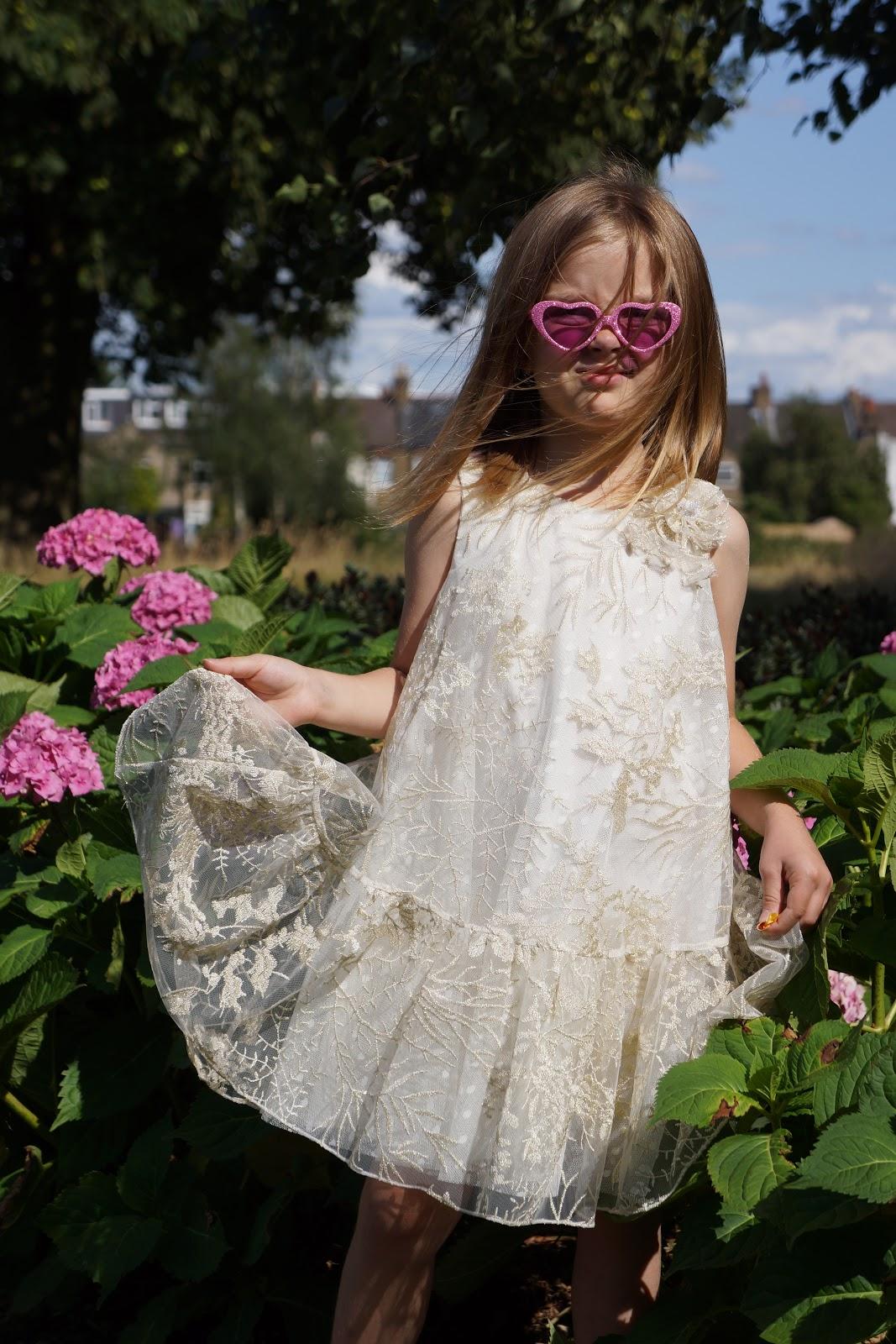 girl in a cream and gold thread David Charles Childrenswear luxury dress
