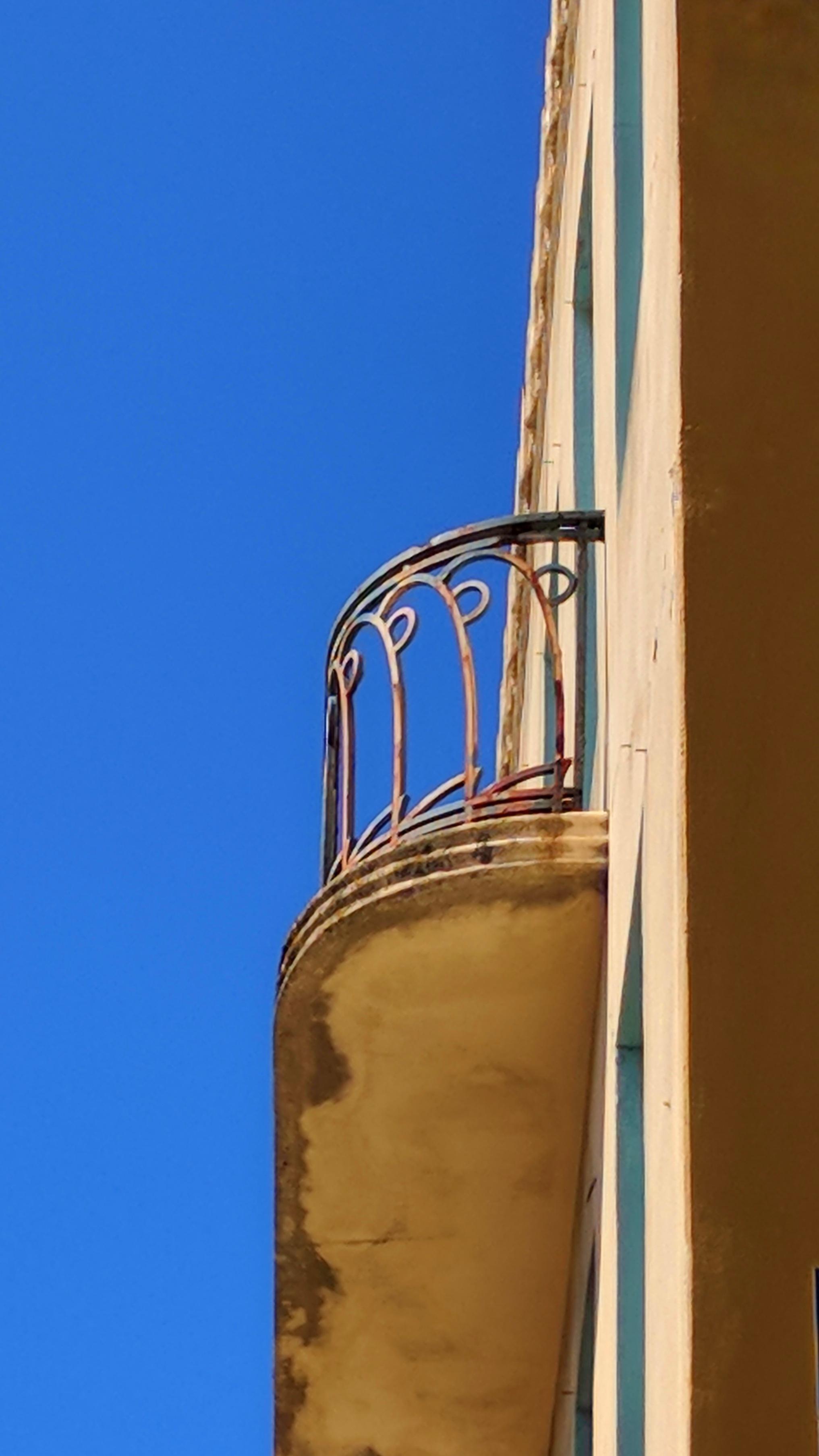 Building balcony against a clear blue sky