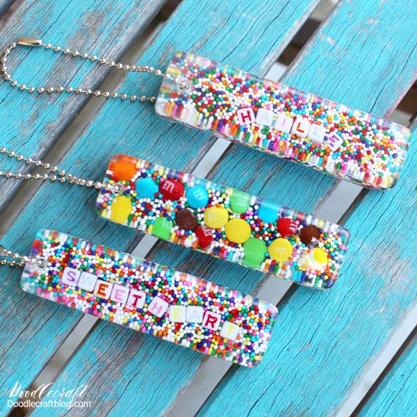 Candy sprinkles in resin key chains.