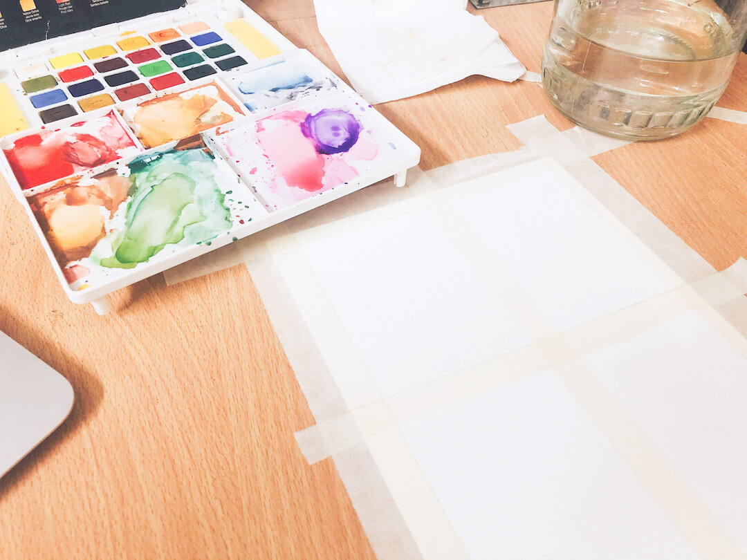 use masking tape to secure your watercolour paper in place