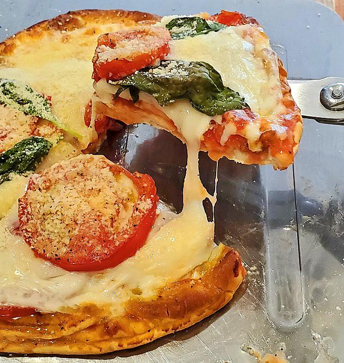 pizza bread made with pita bread into a tomato basil