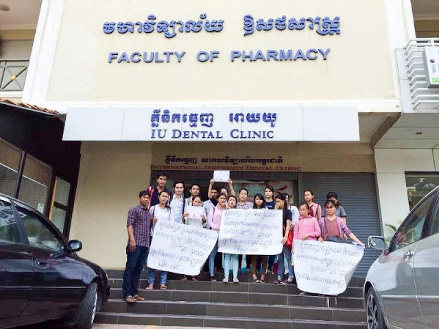 International University students protest outside the Faculty of Pharmacy in Phnom Penh after they were told their recently acquired associate's degrees did not entitle them to open pharmacies. Photo supplied