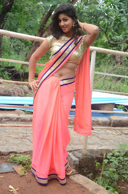 Pavani sizzles in Solid Color saree and Golden Choli exposing her   hole WOW What a deep