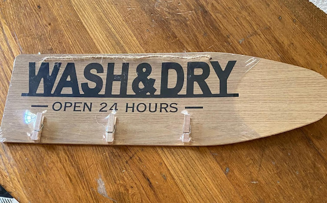 Photo of a Dollar Tree Wash & Dry Sign With Clothespins