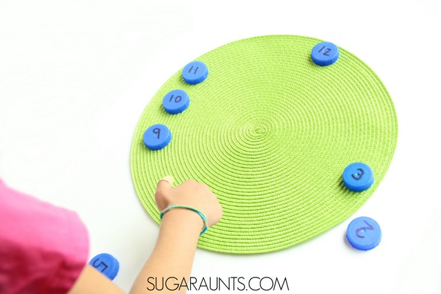 Teach kids how to tell time with hands on learning in this first grade or second grade time telling activity using recycled bottle caps.  Build a clock and practice telling time!
