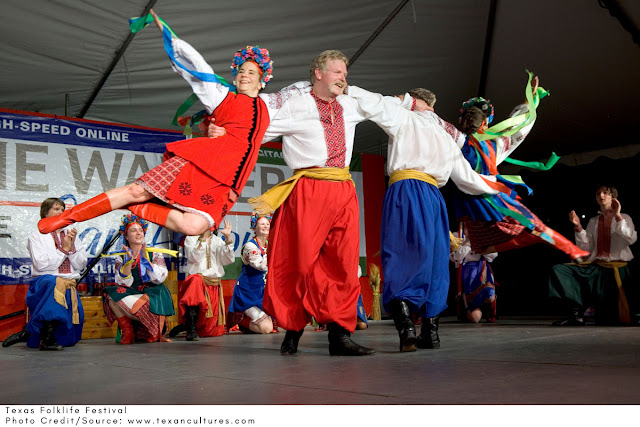 dancers dressed in traditional folk clothing