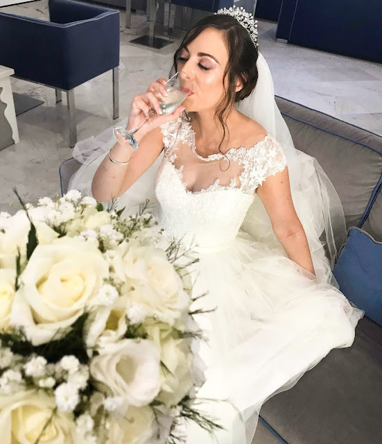 Me, sipping prosecco in Italy in my wedding dress.