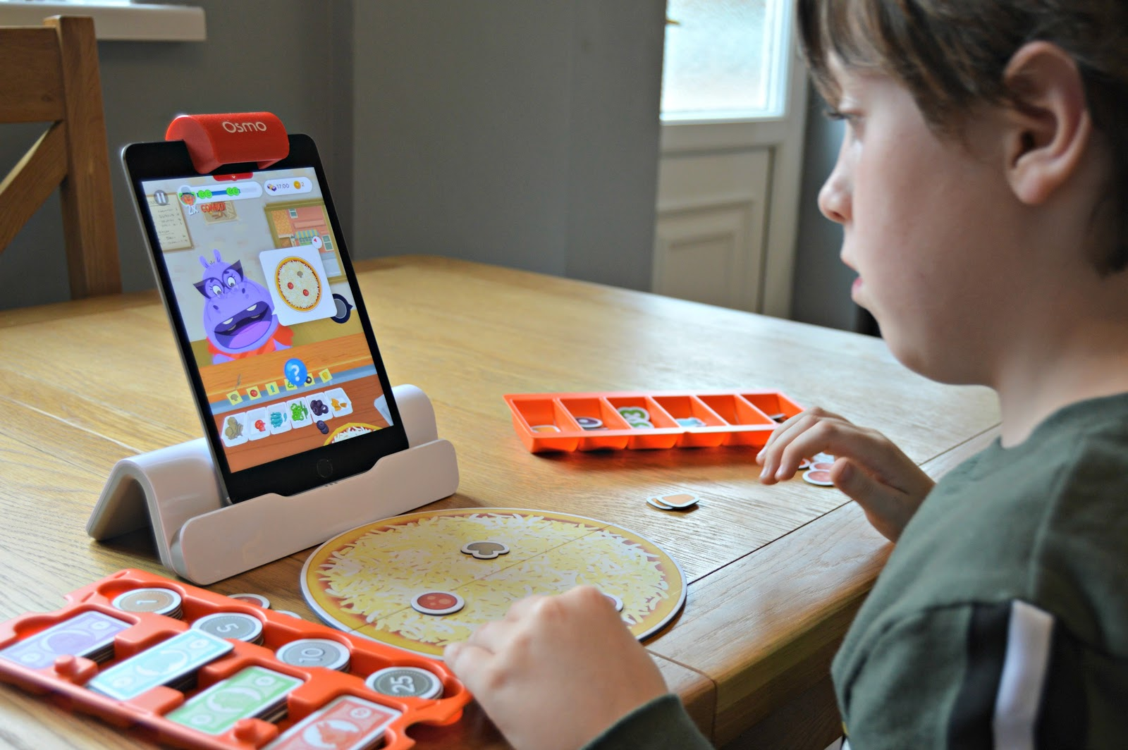 boy playing a game on iPad