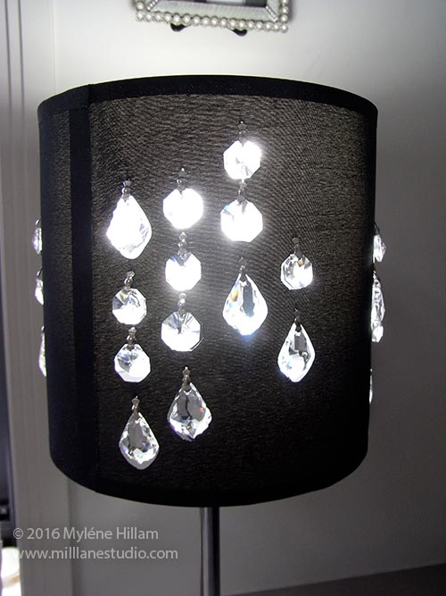 Plain black cylinder lamp shade inset with sparkly Swarovski crystals.