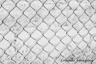 Professional quality fine art photograph of a snow-covered chain link fence in Pocatello, Bannock, Idaho by Cramer Imaging