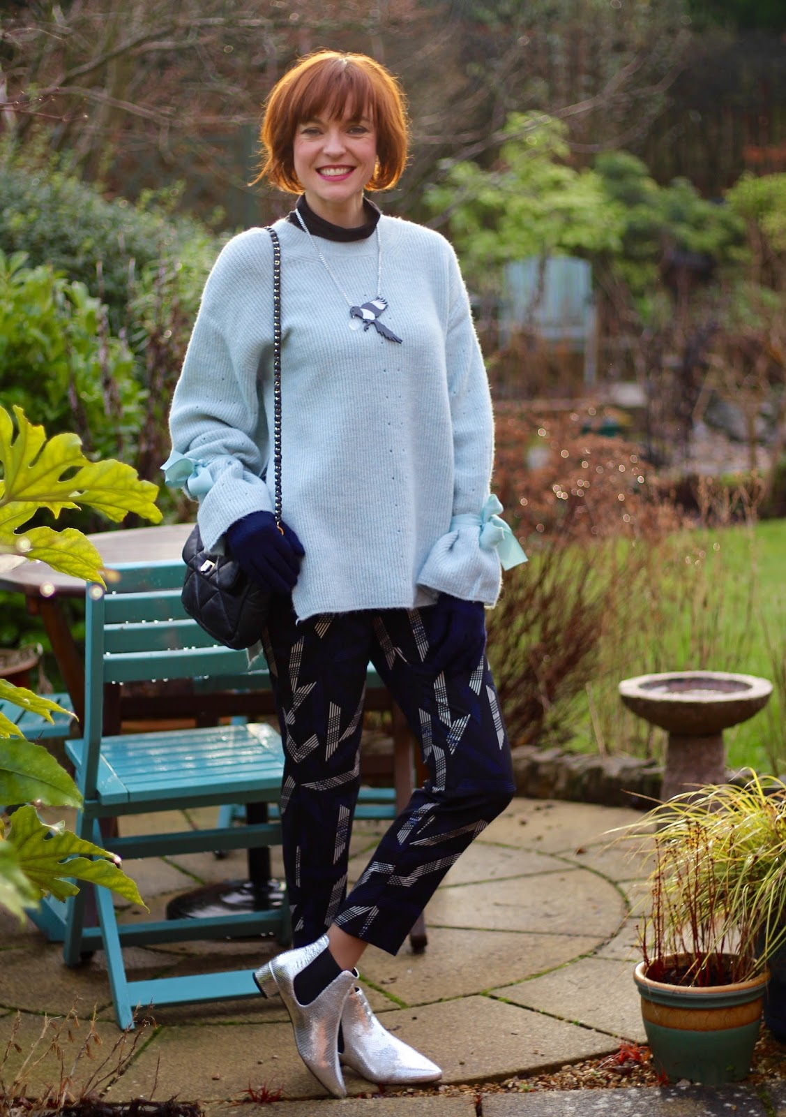 Oversized Topshop Jumper with Statement sleeves, patterned trousers and silver boots | Fake fabulous - style over 40.