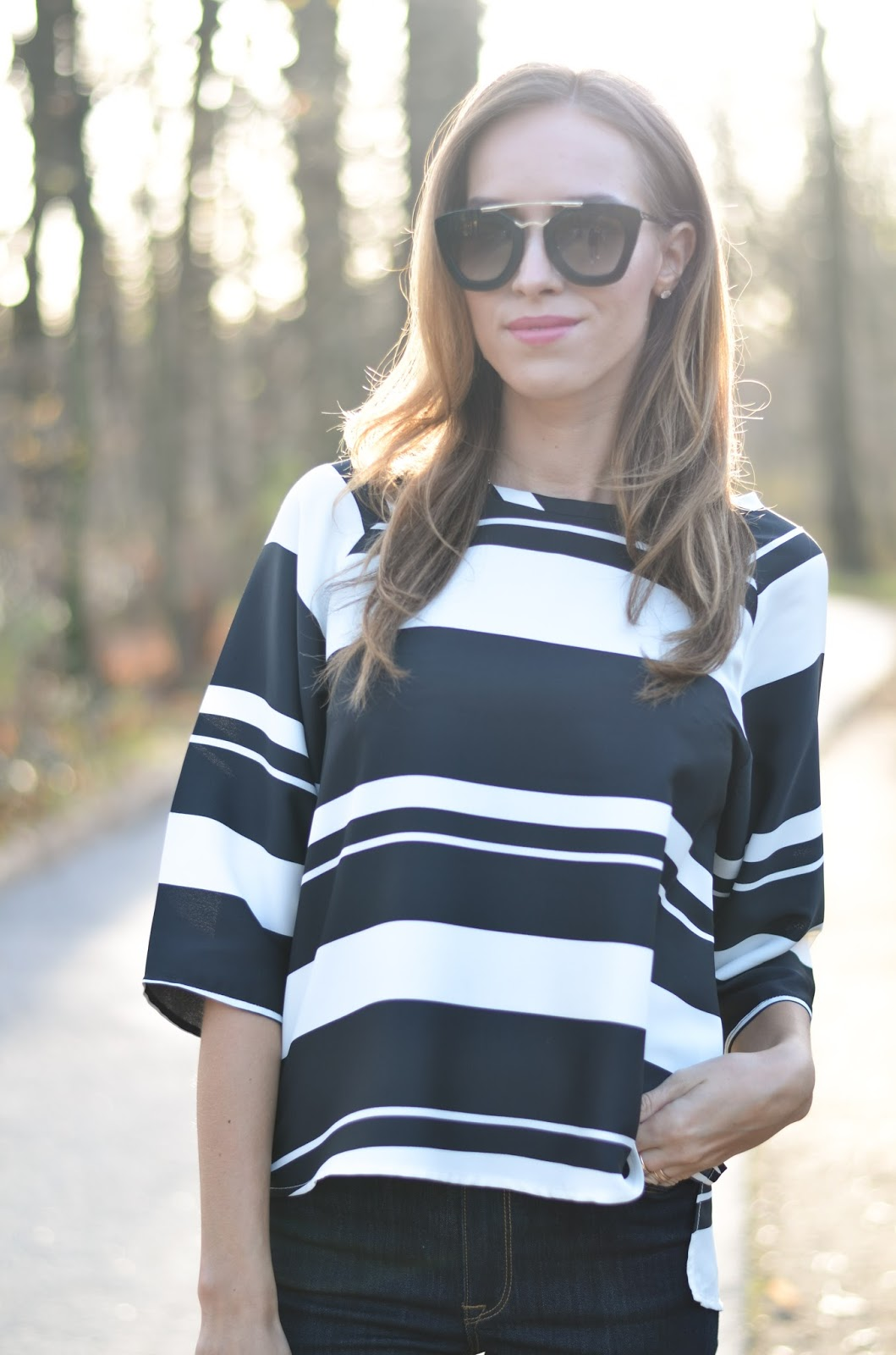 kristjaana mere blue white stripe blouse prada cat eye sunglasses backlight