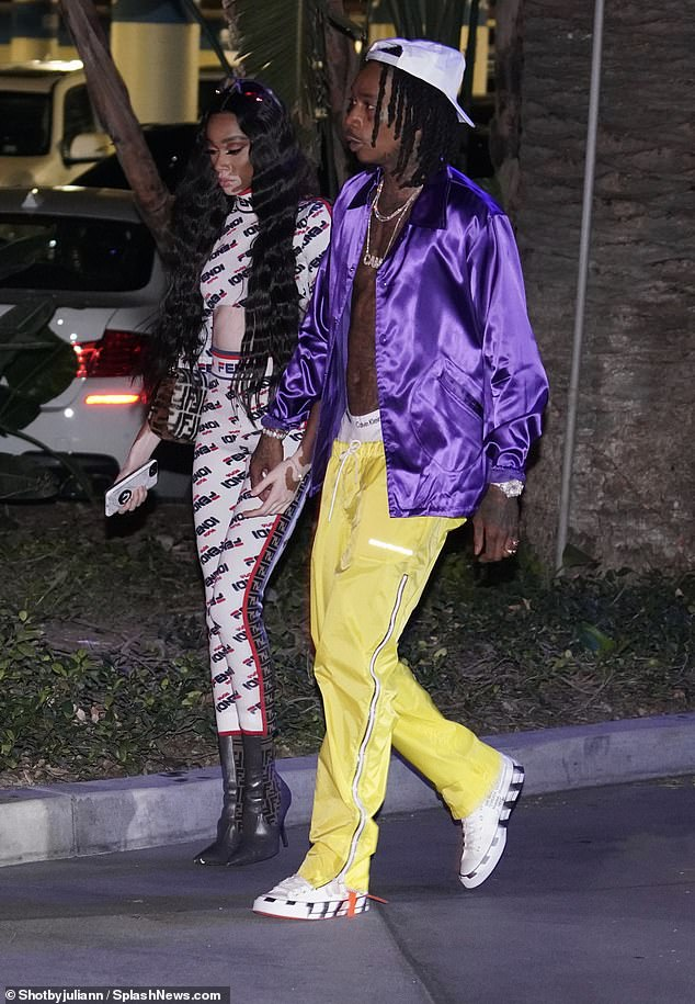 Winnie Harlow puts on a cosy display with Wiz Khalifa months after confirming romance