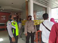 Polsek Firdaus Monitor Pelaksanaan Penyaluran BST di Kantor Pos Indonesia Sei Rampah