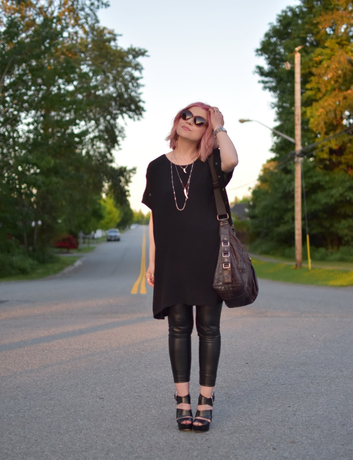 Monika Faulkner outfit inspiration - styling a tunic dress with vegan leather leggings and platform sandals