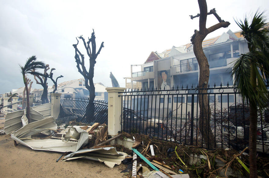 30 Shocking Pictures That Show How Catastrophic Hurricane Irma Is - Smoke Rises From A Fire Amid Debris And Damaged Buildings In Marigot, Near The Bay Of Nettle, On The French Island Of Saint Martin On Wednesday