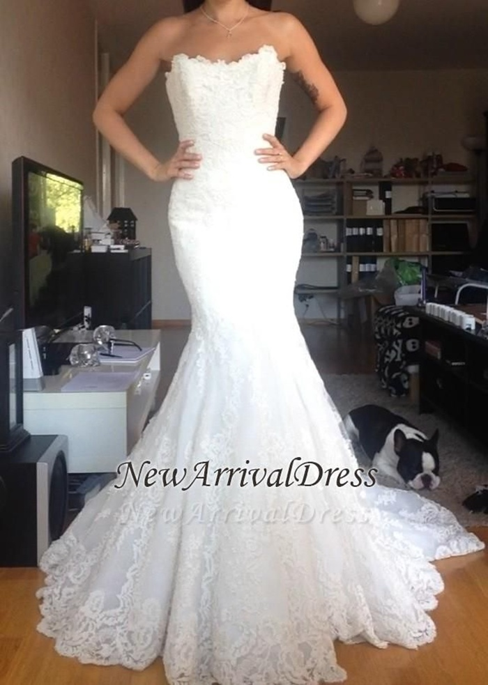 https://www.newarrivaldress.com/g/strapless-tulle-appliques-simple-white-buttons-wedding-dress-107149.html?cate_2=77