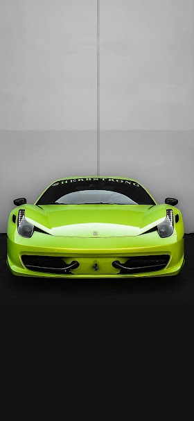 Green ferrari on black asphalt wallpaper