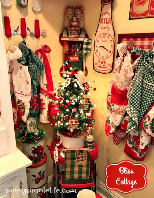 kitchen Christmas tree, vintage aprons on rack