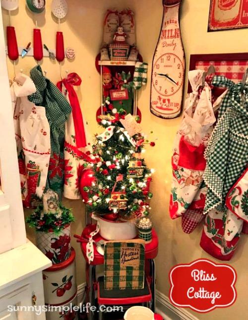kitchen Christmas tree, vintage aprons on rack