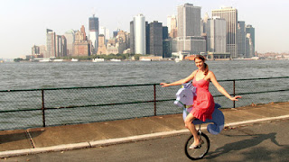 girl on unicycle