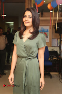 Actress Raashi Khanna Stills in Green Short Dress at Mirchi 95 Suno Aur Mercedes Jeeto Contest  0022