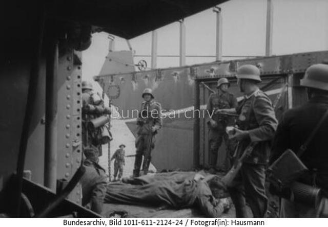 German soldiers examining a captured landing craft after the Dieppe raid worldwartwo.filminspector.com