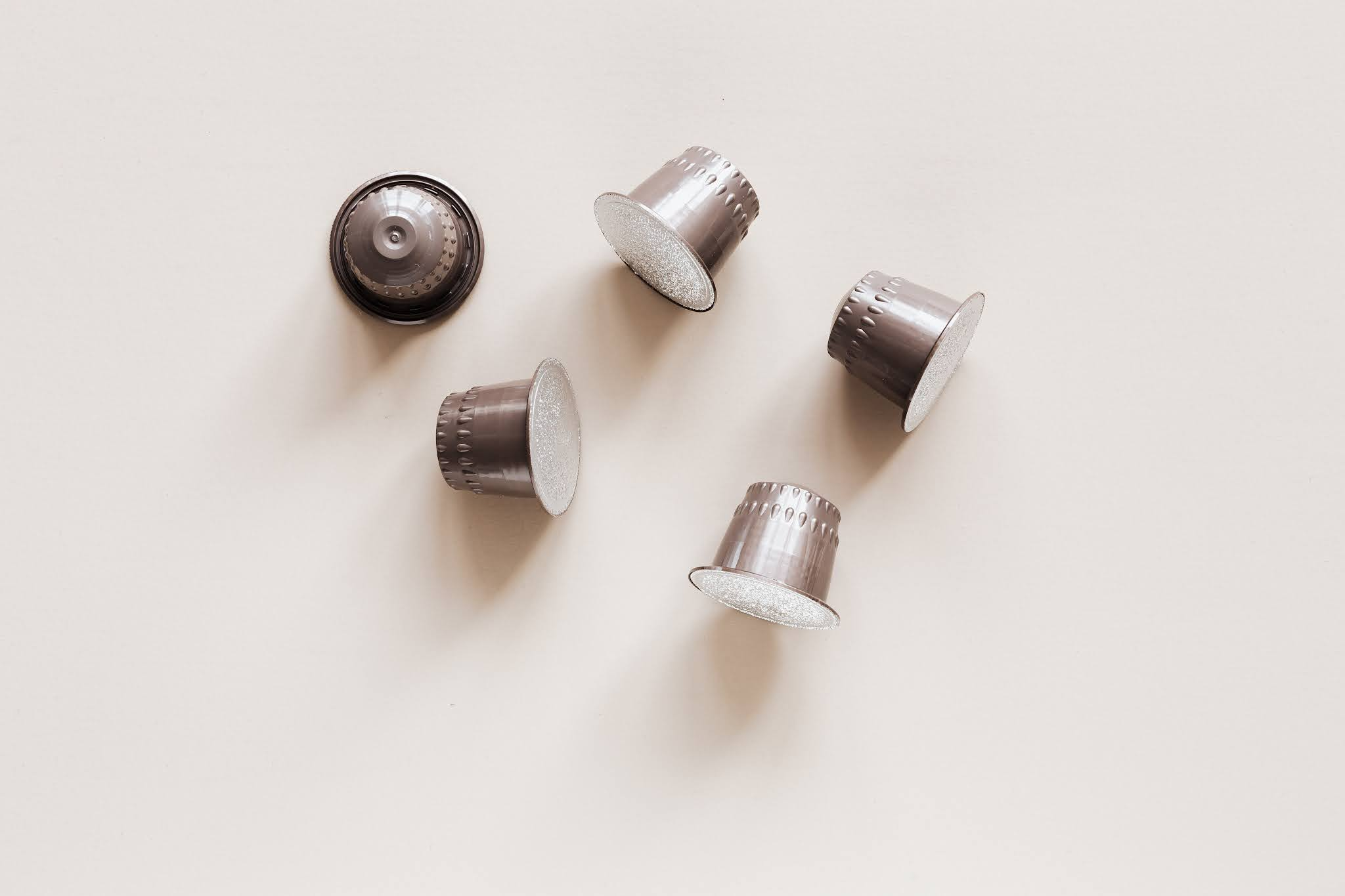 stock image of coffee pods in plain silver packaging