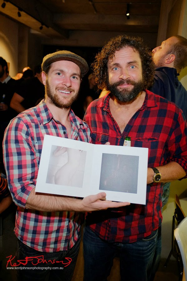 Ingvar Kenne with Kenne book at Black Eye Gallery for The Nude and The Naked opening. Portrait by Kent Johnson.