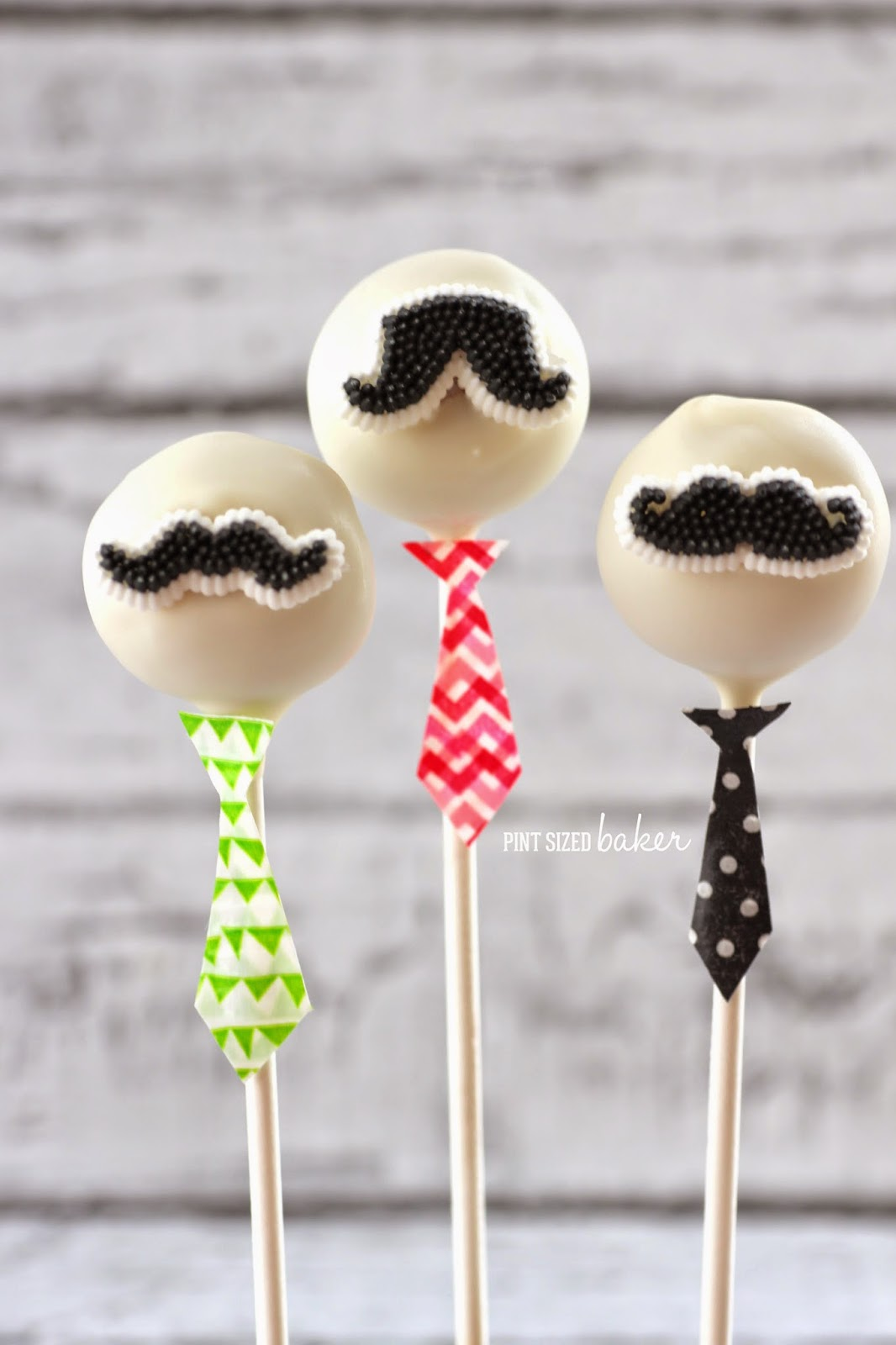 Just Little Bald Headed Cake Pops With Big Mustaches And A Fancy Tie On For Work