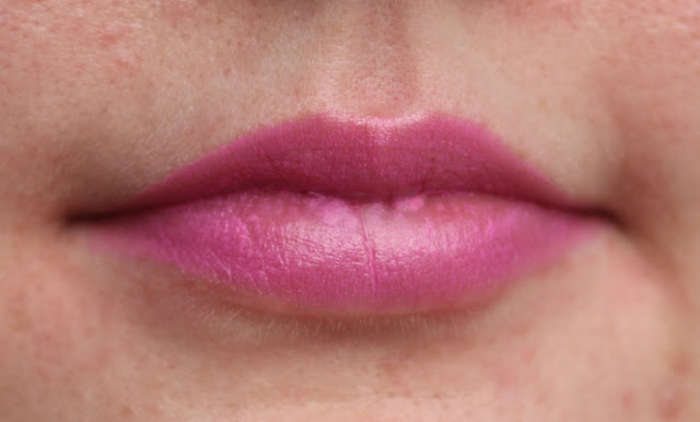 Photograph of Girls Best Friend rose gold lipstick on the lips